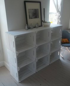 DIY: Crate Storage Bookshelf // Get some crates and paint them white and use them as a shelf