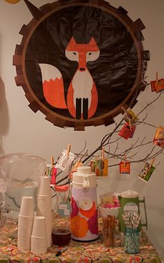 Tree branch with tea/snacks attached with clothespins. (Could also display his monthly pictures)