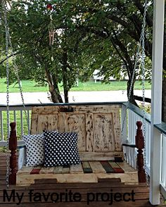 Porch swing I made from a pallet, headboard, door, and table legs