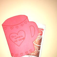 """valentine you warm my heart."" so simple & sweet.   fold a sheet of construction paper in half and trace onto the paper the mug shape. cut out the shape from both sides of the paper. draw the borders & write a message and voila! holds one packet of hot cocoa....might have to think of another saying, but this might possibly be Hunter's valentines :)"
