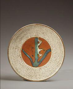 Shimaoka-Tatsuzô ( 1919 – 2007 ) Round platter with slip-filled, cord-impressed pattern and floral design on iron glaze ground, 1972