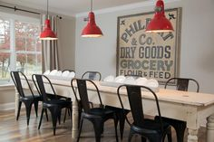 Joanna Gaines found this 10-foot wooden farm table at the Round Top flea market and paired it with a set of metal industrial chairs, creating a decidedly casual dining space.