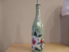 Hand Painted Wine Bottle with Roses by NiftyNikkisNikNaks on Etsy, $20.00