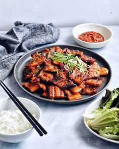 Crispy, fatty pieces of pork belly. Spicy Pork Belly Bulgogi is the indulgent dish you'll want to cook over and over again. Pork Belly Recipes, Spicy Recipes, Asian Recipes, Water Recipes, Grilling Recipes, Hawaiian Recipes, Pork Bulgogi Recipe, Korean Pork Belly, Pork Belly Strips