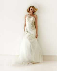 Goddess wedding gown  Grecian-inspired draping on one long swoosh of tulle elongates the body and shows off the new erogenous zone: the shoulders.  Melissa Sweet Gown Style MS251007, $950, davidsbridal.com