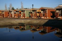 The diminutive houses are part of Quixote Village, a community of formerly homeless adults in Olympia, Washington. Each house is only 144 square feet, with just enough room for a bed, a desk and chair, and a tiny bathroom with a toilet and sink. Showers and a kitchen are located in a community center shared by all the residents.
