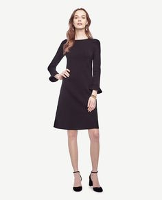 """Finished with feminine fluted sleeves, our refined sweater dress ends on the sleekest note. Jewel neck. Long sleeves. 17 1/4"""" from natural waist."""