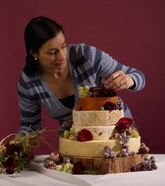 putting a cheese wheel cake together