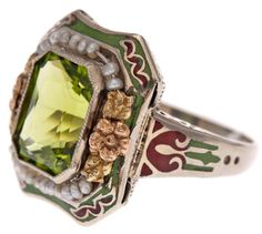 Alternate view: Antique peridot, enamel, and pearl ring, circa 1900. Via Diamonds in the Library.