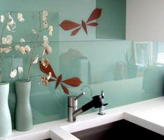 I really love this for a back splash idea in my apartment. Paint the wall, put up some pretty decals and protect it with some plexiglass :)