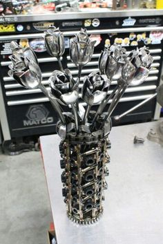 Metal art roses made from arp bolts Metalart motorsports racing welding cars metal art