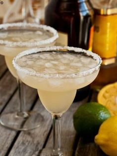 Homemade Margaritas  ½ cup freshly squeezed lime juice 2 tablespoons freshly squeezed lemon juice 1 cup Triple Sec or Grand Marnier  1 cup tequila 3 cups crushed ice Kosher salt 1 lime
