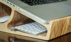 CNC carved laptop stand on the inventables website -not bad but  I think the greentundesign.be bamboo puzzle laptop stand is a more elegant solution! (and wasting less material to make)