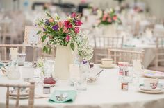 Wedding Tables with Jugs of Pretty Flowers