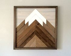 This reclaimed wood mountain scene is handmade from salvaged aged lumber. Each design may vary slightly in color and appearance. Some of the wood has been stained with an all natural earth pigment stain. Some pieces of the modern art design have been white washed with Annie Sloan pure white, and Annie Sloan pairs grey. The frame around the art piece can be left natural, stained light or dark or white washed. Over sized wall art is popular to hang above a mantel, or used as a vocal point in…