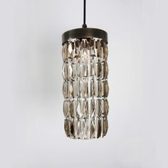 Add a note of understated modern elegance to your interior with our smoke crystal pendant. $253