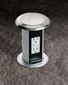 Pop-up Outlet for kitchen bar. So cool. Love how if you don't need it, you don't have to look at it!