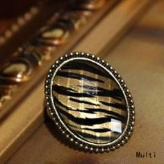http://crazyberry.in/online-shopping/artificial-imitation-fashion-jewellery/oval-stripe-golden-black-gem-ring
