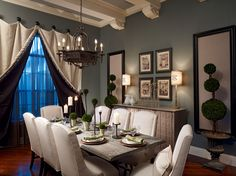 swinging door Traditional Dining Room Decoration ideas Orlando apothecary beams buffet ceiling treatment chandelier dark gray wall dining chairs dining table framed wall art hardwood floor place settings topiary transitional wall panels window treatment