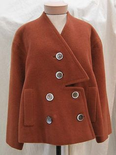 Coat.  Elsa Schiaparelli  (Italian, 1890–1973).  Date: 1949. Culture: French. Medium: wool, silk. Dimensions: Length at CB: 26 in. (66 cm).