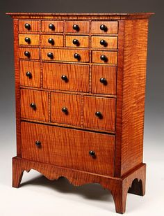 COUNTERTOP APOTHECARY CHEST - Eighteen Drawer Apothecary Chest in tiger maple, with molded top, the drawers in graduated size and numbe