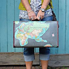 Learn how to make your own vintage map suitcase to decorate your home and store travel memorabilia, photos, trinkets, maps etc that you collect on vacation. Pillar Box Blue featured on Kenarry.com