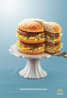 DOMINANCE: as it is a McDonalds advertisement, this poster has great emphasis on the BIG MAC which is what McDonalds is renowned for. The photo background is plain, thus nothing else but this burger stands out, which shows the audience that this is the burgers birthday.