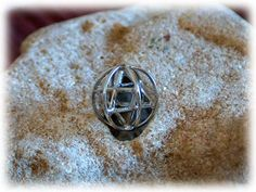 Merkaba+With+Prana+Sphere+Silver+Small+-+A+Symbol+of+the+Healing+Powers+of+Merkaba.+The Merkaba+is+a+powerful+healing+and+protection+tool!  The+Merkaba+pendant+symbolizes the+flow+of+Prana+energy+(life+force+energy)+in+our+body.++By utilizing+the+ancient+Prana+breathing+technique,+we+are+able+to+restore the+Prana+flow+through+the+pineal+gland+at+the+center+of+our+brain.++  The+Merkaba+with+Prana+sphere is+actually+a+more+accurate+model+of+the+Merkaba+as+it+represents+the energetic+...