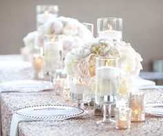 A mix of white and soft pink peonies adds depth to a table flooded in candlelight.