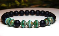Unique men's gemstone bracelet made with a 8mm Ebony Wood and Blue/Green Czech…