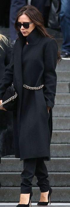 Who made Victoria Beckham's black coat, sunglasses, chain coat, handbag, and…