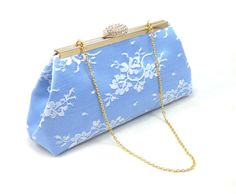 Pantone colors of the year for 2016! Serenity Blue and Rose Quarts Bridal Clutch. Get yours here http://www.ellawinston.com/collections/bridal-clutches/products/serenity-blue-white-lace-and-rose-quartz-bridal-clutch $46.89 #weddingclutch #bridalclutch #somethingblue