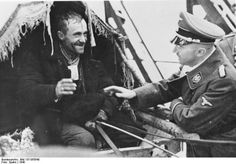 Heinrich Himmler greets a German 'settler' who is to be given new accommodation in German occupied Poland. 1940.