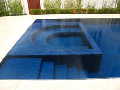 Sunken spa, tile spa, reverse edge pool.  Infinity edge pool.  The water is level with the deck.