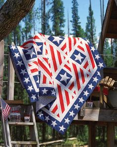 Home of the Brave, by Jean Nolte, is an original quilt design made especially for Quilts of Valor. Solid red, white, and blue fabrics mimic the American flag to honor our veterans. A star border brings it all together.