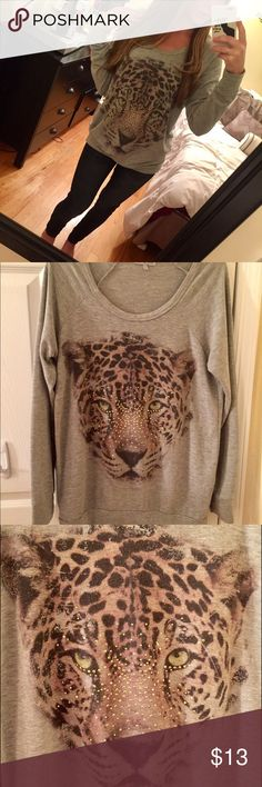 Leopard face long sleeve shirt Comfy long sleeve gray shirt with leopard face printed on the front from Charlette Russe. Leopard face is printed on along with rhinestones. Size small. Kinda on the long side, but looks super cute with jeans or leggings Good condition. No trades ❌ Charlotte Russe Tops Tees - Long Sleeve
