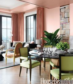 The open living and dining area, painted Salmon Peach in Benjamin Moore Aura, was toned down with a custom bronze glaze.   - HouseBeautiful.com