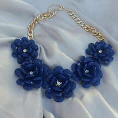 Blue flower necklace Stylish and trendy necklace.  Perfect for the spring or summer!! Chain is gold Jewelry Necklaces