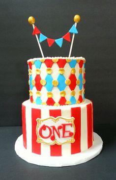 Carnival 1st birthday cake. Www.facebook.com/clairescutecakes