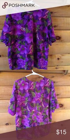 BIG SALE!! Silk Blouse in Purple Florals Short Sleeve Silky Purple Floral Blouse with Back Neckline Button Loop Closure.  Very Comfortable and Cool Top. Wear it under the listed purple silky front button closure shirt. Bundle them for a 10% discount. Tops Blouses