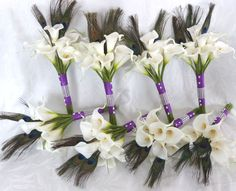 calla+lilies+and+peacock+feathers+arrangements | Request a custom order and have something made just for you.