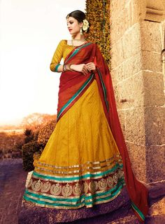 Shop online red and yellow brocade and net bridal lehenga choli online, this bridal lehenga choli is perfect for any occasion, this bridal lehenga choli is prettified with lace, patch border and crystal which gives trendy look. Brocade Lehenga, Net Lehenga, Lehenga Choli Online, Saree, Wedding Chaniya Choli, Bridal Lehenga Choli, Indian Dresses, Indian Outfits, Suits For Women