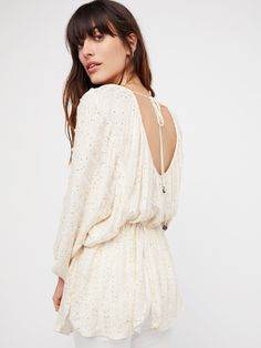 Little Shine Tunic | Lightweight and semi-sheer tunic featuring a little shine with allover sequin detailing.    * Dolman style sleeves   * Elastic cuffs and waistband   * Low scoop back with adjustable tie   * Slit detailing along the hem