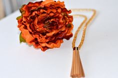Gold beaded necklace with gold plated leather tassel.    Qty per listing: 1