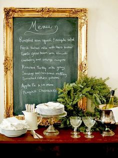 Christmas tablescape for next year. Love the gold framed menu board