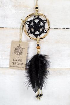 This small crocheted dream catcher wall decor will make a great decorative touch to any interior or your car.