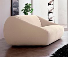 Sofa with shockproof ABS feet. Structured in wooden frame. Shaped insert is in polyurethane foam with different densities. Cover is fully removable.