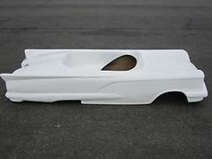 This is a 1958 Ford Thunderbird Convertible Fiberglass car body. Description from ebay.com. I searched for this on bing.com/images