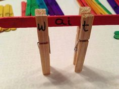 Phonics pegs and lollipop sticks Use flashcards and pegs instead of writing letter on pegs. Can also use for the colours of the rainbow. Phonics Reading, Jolly Phonics, Spelling Activities, Phonics Activities, Early Literacy, Literacy Activities, Teaching Reading, Reading Activities, Literacy Centers