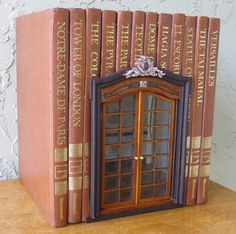 Thanks mollykpotts for this post. Stop Everything and Check Out these Miniature Book Houses So her. Stop Everything and Check Out these Miniature Book Houses Miniature Rooms, Miniature Crafts, Miniature Houses, Old Book Crafts, Book Page Crafts, Folded Book Art, Book Folding, Recycled Books, Recycled Materials